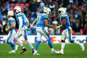 Philip Rivers #17 of the Los Angeles Chargers celebrates victory with Adrian Phillips #31 of the Los Angeles Chargers during the NFL International Series game between Tennessee Titans and Los Angeles Chargers at Wembley Stadium on October 21, 2018 in London, England.