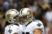 Jimmy Graham #80 of the New Orleans Saints celebrates with Senio Kelemete #65 during a preseason game against the Tennessee Titans at the Mercedes-Benz Superdome on August 15, 2014 in New Orleans, Louisiana.