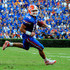 Tim Tebow Photos - Tim Tebow #15 of the Florida Gators scrambles for yardage during the game against the Tennessee Volunteers at Ben Hill Griffin Stadium on September 19, 2009 in Gainesville, Florida. - Tennessee v Florida