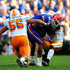 Nick Reveiz Photos - Aaron Hernandez #81 of the Florida Gators is tackled by Nick Reveiz #56 of the Tennessee Volunteers during the game at Ben Hill Griffin Stadium on September 19, 2009 in Gainesville, Florida. - Tennessee v Florida