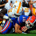 Nick Reveiz Photos - Tim Tebow #15 of the Florida Gators is tackled by Nick Reveiz #56 of the Tennessee Volunteers during the game at Ben Hill Griffin Stadium on September 19, 2009 in Gainesville, Florida. - Tennessee v Florida