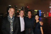 (L to R) Alan Taylor, Paramount Vice Chairman Rob Moore, Arnold Schwarzenegger, and Betty Zhou pose on a boat at the Bund to promote the Terminator Genisys release in China on August 20, 2015 in Shanghai, China.