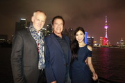 (L to R) Alan Taylor, Arnold Schwarzenegger, and Betty Zhou pose on a boat at the Bund to promote the Terminator Genisys release in China on August 20, 2015 in Shanghai, China.