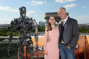 Actress Emilia Clarke and Director Alan Taylor pose with Endoskeleton during the France Photocall of 'Terminator Genisys' at the Publicis Champs Elysees on June 19, 2015 in Paris, France.