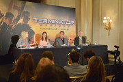 (L-R) Moderator Béatrice Wachsberger, Actors Emilia Clarke and Arnold Schwarzenegger and Director Alan Taylor attend the France Press Junket of 'Terminator Genisys' at the Hotel Four Season Georges V on June 19, 2015 in Paris, France.