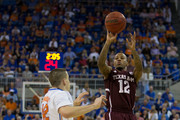 Fabyon Harris #12 of the Texas A&M Aggies shoots the ball over Billy Donovan #42 of the Florida Gators during the second half of play at the Stephen C. O'Connell Center on February 01, 2014 in Gainesville, Florida.