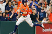 Derek Fisher #21 of the Houston Astros scores on an error by Drew Robinson #18 of the Texas Rangers on a single by Marwin Gonzalez in the eighth inning at Minute Maid Park on April 13, 2018 in Houston, Texas.