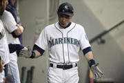 Ichiro Suzuki #51 of the Seattle Mariners claps his hands as he walks through the dugout before a game against the Texas Rangers at Safeco Field on September 29, 2018 in Seattle, Washington.