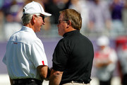 Head coach Tommy Tuberville (L) of the Texas Tech Red Raiders talks with head coach Gary Patterson (R) of the TCU Horned Frogs  at Amon G. Carter Stadium on October 20, 2012 in Fort Worth, Texas.