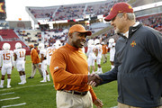 AMES, IA â OCTOBER 31: Head coach Charlie Strong of the Texas Longhorns and head coach Paul Rhoads of the Iowa State Cyclones shake hands at the fifty yard line during pregame warm ups at Jack Trice Stadium on October 31, 2015 in Ames, Iowa.