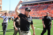 Head Coach Mike Gundy of the Oklahoma State Cowboys walks off the field after the game against the Texas Longhorns October 1, 2016 at Boone Pickens Stadium in Stillwater, Oklahoma. The Cowboys defeated the Longhorns 49-31.