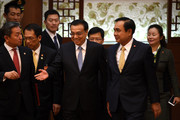 Thai Prime Minister Prayut Chan-o-cha (2nd-R) and Chinese Premier Li Keqiang (C) attend during a signing ceremony at the Great Hall of the People on December 22, 2014 in Beijing, China. Prayut Chan-o-cha is on a visit to China from December 22 to 23.