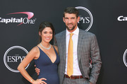 Olympic swimmer Michael Phelps (R) and model Nicole Johnson attend The 2017 ESPYS at Microsoft Theater on July 12, 2017 in Los Angeles, California.