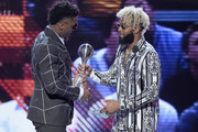 NFL player Odell Beckham Jr. (L) presents the award to NBA player Donovan Mitchell onstage at The 2018 ESPYS at Microsoft Theater on July 18, 2018 in Los Angeles, California.