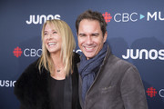 (L-R) Janet Holden and Eric McCormack attend the red carpet arrival at the 2018 Juno Awards at Rogers Arena on March 25, 2018 in Vancouver, Canada.
