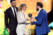 (L-R)  Joel McHale and Mikaela Shiffrin present the Best Comeback award to Ryan O'Reilly of the St. Louis Blues onstage during The 2019 ESPYs at Microsoft Theater on July 10, 2019 in Los Angeles, California.