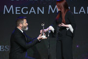 Megan Mullally (R) receives award from Nick Offerman onstage at the 43rd Annual Gracie Awards at the Beverly Wilshire Four Seasons Hotel on May 22, 2018 in Beverly Hills, California.