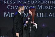 Megan Mullally (R) accepts award from Nick Offerman onstage at the 43rd Annual Gracie Awards at the Beverly Wilshire Four Seasons Hotel on May 22, 2018 in Beverly Hills, California.