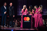 (EDITORIAL USE ONLY) Matt Goss and Luke Goss present the British Artist Video Of The Year award to Jesy Nelson, Leigh-Anne Pinnock, Jade Thirlwall and Perrie Edwards of Little Mix during The BRIT Awards 2019 held at The O2 Arena on February 20, 2019 in London, England.