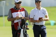 Justin Thomas and his caddie Jimmy Johnson look on during the first round of the Honda Classic at PGA National Resort and Spa on February 22, 2018 in Palm Beach Gardens, Florida.