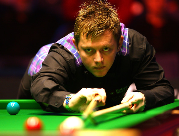 Mark Allen of Ireland takes a shot in his match against John Higgins of Scotland during the PokerStars Masters snooker tournament at Wembley Arena on January 13, 2010 in London, England.