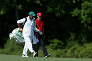 Justin Rose of England talks with his caddie Mark Fulcher during a practice round prior to the start of the 2012 Masters Tournament at Augusta National Golf Club on April 2, 2012 in Augusta, Georgia.