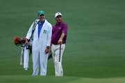 Fred Couples (R) and caddie Joe LaCava look on during a practice round prior to the start of the 2012 Masters Tournament at Augusta National Golf Club on April 3, 2012 in Augusta, Georgia.