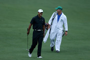 Tiger Woods and his caddie Joe LaCava walk up the fairway during a practice round prior to the start of the 2012 Masters Tournament at Augusta National Golf Club on April 3, 2012 in Augusta, Georgia.
