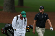 Robert Karlsson of Sweden and his caddie Gareth Lord walk up the fairway during a practice round prior to the start of the 2012 Masters Tournament at Augusta National Golf Club on April 3, 2012 in Augusta, Georgia.