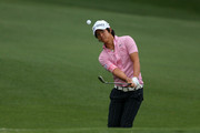 Ryo Ishikawa of Japan hits an approach shot during a practice round prior to the start of the 2012 Masters Tournament at Augusta National Golf Club on April 3, 2012 in Augusta, Georgia.