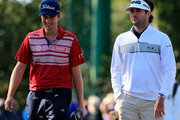 Webb Simpson of the United States and Bubba Watson of the United States during a practice round prior to the start of the 2014 Masters Tournament at Augusta National Golf Club on April 9, 2014 in Augusta, Georgia.