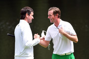 Bubba Watson of the United States and Webb Simpson of the United States embrace on the ninth green during the Par 3 Contest prior to the start of the 2016 Masters Tournament at Augusta National Golf Club on April 6, 2016 in Augusta, Georgia.