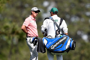 Justin Rose of England waits with his caddie Mark Fulcher during a practice round prior to the start of the 2014 Masters Tournament at Augusta National Golf Club on April 8, 2014 in Augusta, Georgia.