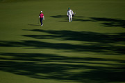 Justin Rose of England walks with his caddie Mark Fulcher during a practice round prior to the start of the 2014 Masters Tournament at Augusta National Golf Club on April 9, 2014 in Augusta, Georgia.