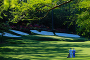 Justin Rose of England waits with his caddie Mark Fulcher on the 13th hole during the first round of the 2014 Masters Tournament at Augusta National Golf Club on April 10, 2014 in Augusta, Georgia.