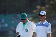 Justin Rose of England and his caddie Mark Fulcher on the 17th during the first round of the 2014 Masters Tournament at Augusta National Golf Club on April 10, 2014 in Augusta, Georgia.