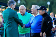 Honorary starters Arnold Palmer, Jack Nicklaus and Gary Player meet with William Porter Payne, chairman of Augusta National Golf Club, on the first tee at the start of the first round of the 2014 Masters Tournament at Augusta National Golf Club on April 10, 2014 in Augusta, Georgia.