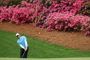 Rory McIlroy of Northern Ireland plays a shot on the 13th hole during the third round of the 2018 Masters Tournament at Augusta National Golf Club on April 7, 2018 in Augusta, Georgia.