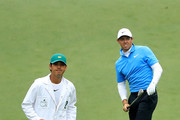 Rory McIlroy of Northern Ireland reacts alongside caddie Harry Diamond on the seventh hole during the third round of the 2018 Masters Tournament at Augusta National Golf Club on April 7, 2018 in Augusta, Georgia.