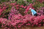 Rory McIlroy of Northern Ireland plays a shot out of the flowers on the 13th hole during the third round of the 2018 Masters Tournament at Augusta National Golf Club on April 7, 2018 in Augusta, Georgia.