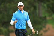 Rory McIlroy of Northern Ireland waves on the seventh green during the third round of the 2018 Masters Tournament at Augusta National Golf Club on April 7, 2018 in Augusta, Georgia.