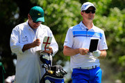 Justin Rose of England and his caddie Mark Fulcher on the fourth tee box during the third round of the 2014 Masters Tournament at Augusta National Golf Club on April 12, 2014 in Augusta, Georgia.