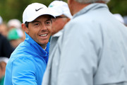 Rory McIlroy of Northern Ireland smiles on the first tee during the third round of the 2018 Masters Tournament at Augusta National Golf Club on April 7, 2018 in Augusta, Georgia.