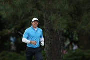 Rory McIlroy of Northern Ireland smiles after playing his second shot on the fifth hole during the third round of the 2018 Masters Tournament at Augusta National Golf Club on April 7, 2018 in Augusta, Georgia.