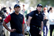 Tiger Woods and Phil Mickelson look on during The Match: Tiger vs Phil at Shadow Creek Golf Course on November 23, 2018 in Las Vegas, Nevada.