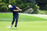 Justin Rose of England plays a shot on the 12th hole  during the final round of The Northern Trust at Liberty National Golf Club on August 11, 2019 in Jersey City, New Jersey.