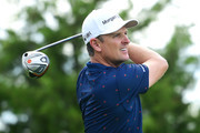 Justin Rose of England plays his shot from the 12th tee during the final round of The Northern Trust at Liberty National Golf Club on August 11, 2019 in Jersey City, New Jersey.
