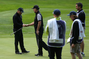 Damien McGrane of the Great Britain and Ireland PGA Cup team celebrates sinking a long range putt for birdie with playing partner David Higgins during the afternoon foursomes matches on day 2 of the 28th PGA Cup at Foxhills Golf Course on September 16, 2017 in Ottershaw, England.