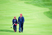 Phil Mickelson of the United States Team and wife Amy Mickelson walk up the 16th fairway during the Sunday singles matches at The Presidents Cup at Jack Nicklaus Golf Club Korea on October 11, 2015 in Songdo IBD, Incheon City, South Korea.