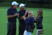 Phil Mickelson and Fred Couples of the U.S. Team wait with Amy Mickelson and Nadine Moze during the Day One Four-Ball Matches at the Muirfield Village Golf Club on October 3, 2013  in Dublin, Ohio.